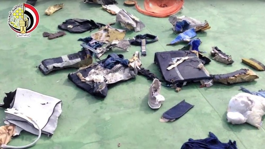 FILE -- This still file image taken from video posted Saturday, May 21, 2016, on the official Facebook page of the Egyptian Armed Forces spokesman shows some personal belongings and other wreckage from EgyptAir flight 804. The plane crashed in the Mediterranean Sea in May, 2016, killing all 66 passengers and crew on board. Egypt's Civil Aviation Ministry said Thursday, Dec. 15, 2016, that traces of explosives have been found on some of the victims of the  flight. A ministry statement said a criminal investigation will now begin into the crash of Flight 804. No one has claimed to have attacked the plane. (Egyptian Armed Forces via AP)