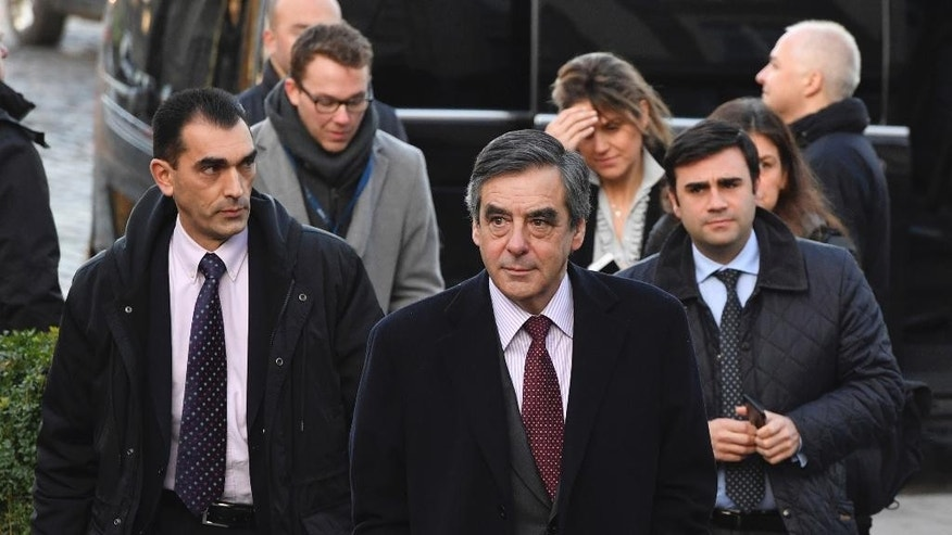Former French Prime Minister Francois Fillon, center, arrives for an EPP meeting ahead of an EU Summit in Brussels on Thursday, Dec. 15, 2016. European Union leaders meet Thursday in Brussels to discuss defense, migration, the conflict in Syria and Britain's plans to leave the bloc. (AP Photo/Geert Vanden Wijngaert)