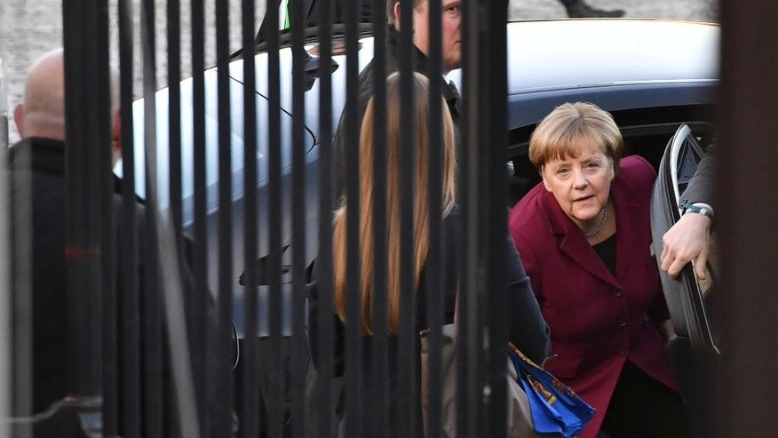 German Chancellor Angela Merkel, right, arrives for an EPP meeting ahead of an EU Summit in Brussels on Thursday, Dec. 15, 2016. European Union leaders meet Thursday in Brussels to discuss defense, migration, the conflict in Syria and Britain's plans to leave the bloc. (AP Photo/Geert Vanden Wijngaert)
