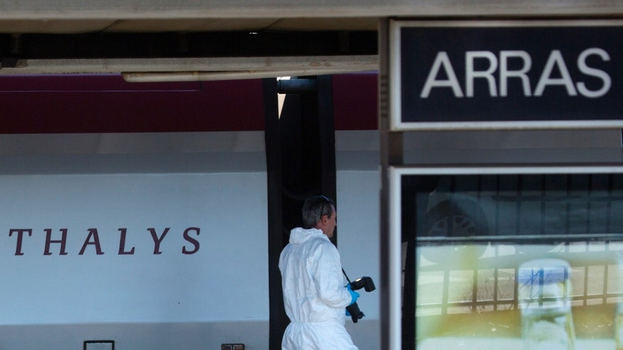 A member of the police forensics team investigates near a Thalys train on a platform at the Arras train station in northern France
