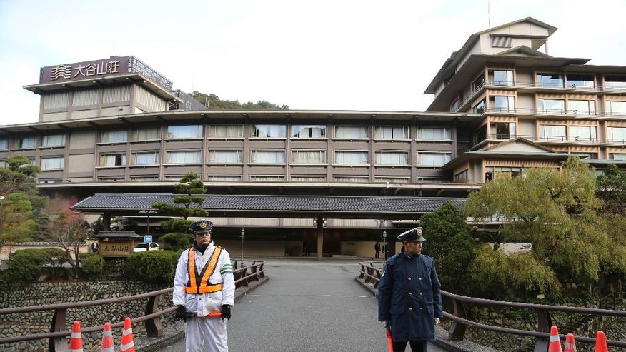 Police officers stand guard in front of a hot spring villa where Japanese Prime Minister Shinzo Abe and Russian President Vladimir Putin will have a meeting in Nagato, western Japan. Thursday, Dec. 15, 2016. Putin will visit Japan Thursday to discuss territorial dispute that has prevented a peace treaty to end World War II, and Japanese investment in eastern Russia. (AP Photo/Koji Sasahara)
