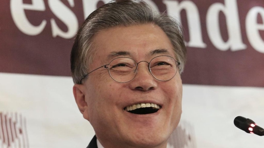 Possible South Korean presidential contender Moon Jae-in laughs during a press conference at the Seoul Foreign Correspondents Club in Seoul, South Korea, Thursday, Dec. 15, 2016. Opposition politician Moon says South Korea should reconsider its plans to deploy an advanced U.S. missile defense system to cope with North Korean threats. (AP Photo/Ahn Young-joon)