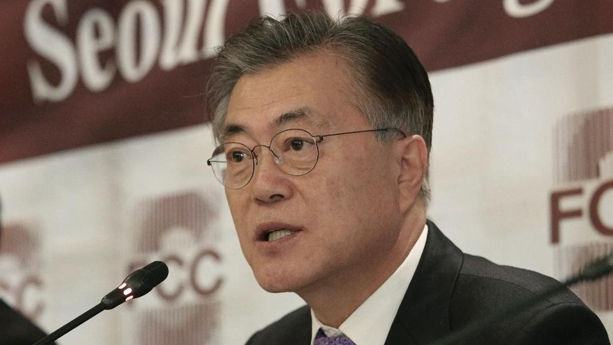 Possible South Korean presidential contender Moon Jae-in speaks during a press conference at the Seoul Foreign Correspondents Club in Seoul, South Korea, Thursday, Dec. 15, 2016. Opposition politician Moon says South Korea should reconsider its plans to deploy an advanced U.S. missile defense system to cope with North Korean threats. (AP Photo/Ahn Young-joon)