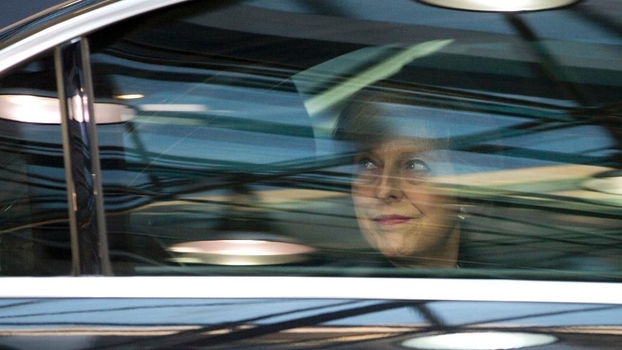 British Prime Minister Theresa May, looks out from her car window as she arrives for an EU Summit in Brussels on Thursday, Dec. 15, 2016. European Union leaders meet Thursday in Brussels to discuss defense, migration, the conflict in Syria and Britain's plans to leave the bloc. (AP Photo/Virginia Mayo)
