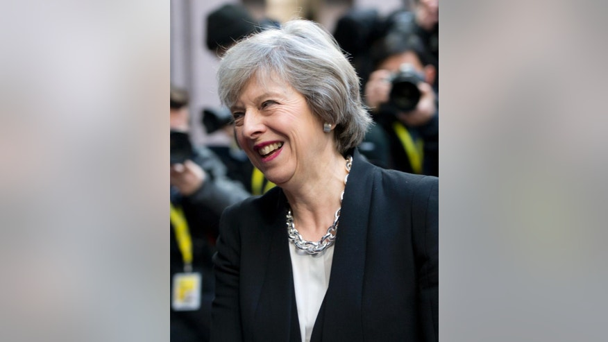British Prime Minister Theresa May arrives for an EU Summit in Brussels on Thursday, Dec. 15, 2016. European Union leaders meet Thursday in Brussels to discuss defense, migration, the conflict in Syria and Britain's plans to leave the bloc. (AP Photo/Virginia Mayo)