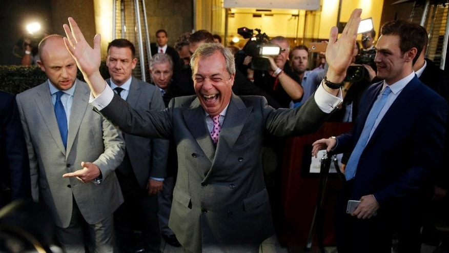 "FILE - In this Friday, June 24, 2016 file photo Nigel Farage, the leader of the UK Independence Party celebrates as he poses for photographers as he leaves a ""Leave.EU"" organization party for the British European Union membership referendum in London. The British people voted by 52% in favour of leaving the European Union in the referendum on June 23. (AP Photo/Matt Dunham, File)"