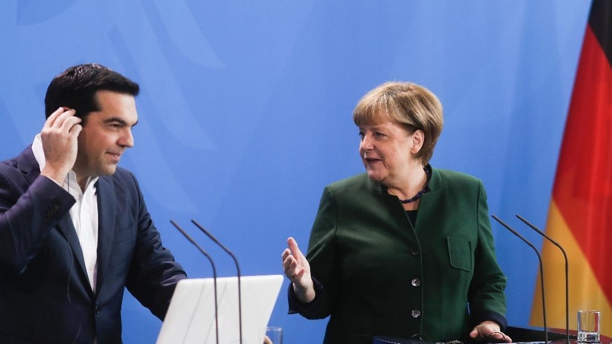 German Chancellor Angela Merkel, right, and Greek Prime Minister Alexis Tsipras brief the media prior to talks at the chancellery in Berlin, Germany, Friday, Dec. 16, 2016. (AP Photo/Markus Schreiber)