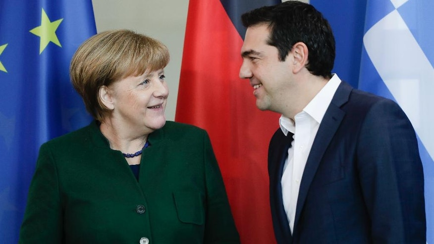 German Chancellor Angela Merkel, left, and Greek Prime Minister Alexis Tsipras attend a joint statement prior to talks at the chancellery in Berlin, Germany, Friday, Dec. 16, 2016. (AP Photo/Markus Schreiber)