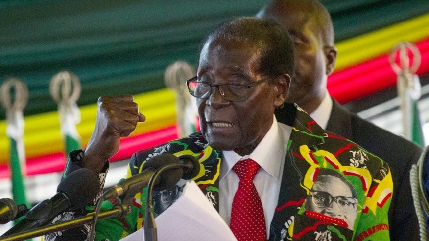 Zimbabwe President Robert Mugabe delivers his speech at the opening session of his party's 16th Annual Peoples Conference in Masvingo, about 300 kilometres, south of the capital Harare, Friday Dec. 16, 2016. Mugabe officially opened the conference where he is set to be endorsed as the ruling party candidate for Presidential elections set for 2018. (AP Photo/Tsvangirayi Mukwazhi)