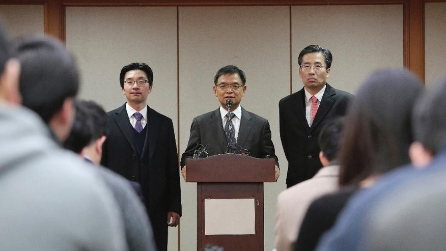 Lee Joong-hwan, center, a lawyer for impeached South Korean President Park Geun-hye, speaks during a press conference at the Constitutional Court in Seoul, South Korea, Friday, Dec. 16, 2016. Lee says the Constitutional Court should restore her powers because there's not enough evidence to justify her unseating. (AP Photo/Ahn Young-joon)