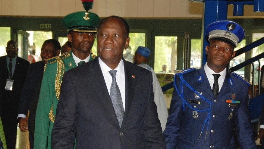 Ivory Coast President, Alassane Ouattara, arrives for the  Economic Community Of West African States, ECOWAS, Heads of State and Government summit in Abuja, Nigeria, Saturday, Dec. 17, 2016. (AP Photo/Olamikan Gbemiga)