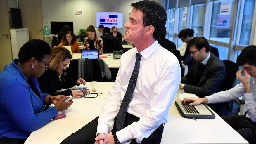 Former French Prime Minister Manuel Valls, now candidate for the socialist party primary election, is pictured during the inauguration of his campaign headquarters, Wednesday Dec. 14, 2016, in Paris. Valls hopes to unite the Socialists under his banner and give the left a chance to stay at the Elysee, in the most ambitious challenge of his political life after president Francois Hollande decided not to run for re-election next year. (Alain Jocard, Pool via AP)