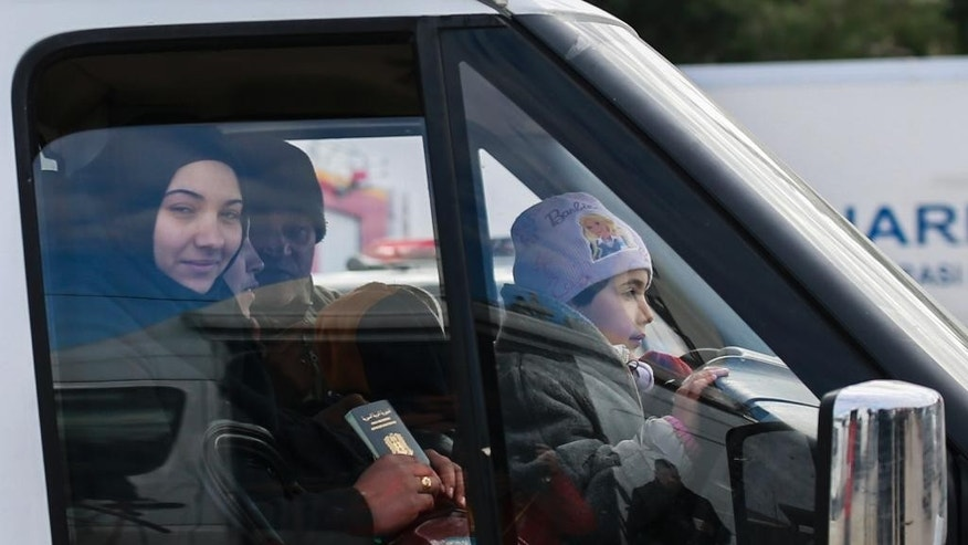 Members of a Syrian family are driven after crossing into Turkey at the Cilvegozu border gate with Syria, near Hatay, southeastern Turkey, Sunday, Dec, 18, 2016. Several people were able to cross into Turkey after they managed to leave the embattled Syrian city. The Aleppo evacuation was suspended Friday after a report of shooting at a crossing point into the enclave by both sides of the conflict. (AP Photo/Emrah Gurel)
