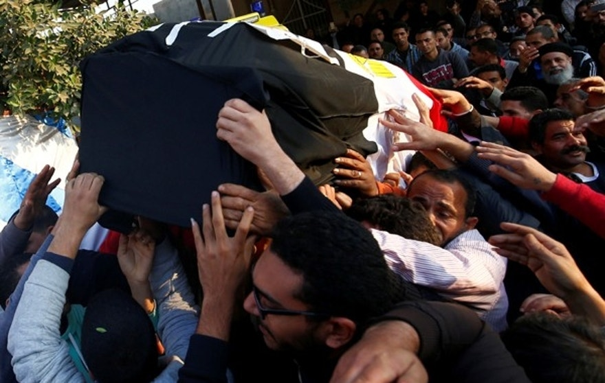 Relatives of a Christian woman who was killed in the bombing of Cairo's main Coptic cathedral, carry her body to bury at the Mokattam Cemetery in Cairo, Egypt December 12, 2016. REUTERS/Amr Abdallah Dalsh - RTX2UOY7