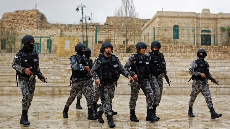 Jordanian security forces patrol in front of Karak Castle in the central town of Karak, about 140 kilometers (87 miles) south of the capital Amman, in Jordan Monday, Dec. 19, 2016. Gunmen assaulted Jordanian police in a series of attacks Sunday, including at the Karak Crusader castle popular with tourists, killing seven officers, two local civilians and a woman visiting from Canada, officials said. (AP Photo/Ben Curtis)