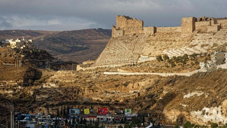 Karak Castle is seen in the central town of Karak, about 140 kilometers (87 miles) south of the capital Amman, in Jordan Monday, Dec. 19, 2016. Gunmen assaulted Jordanian police in a series of attacks Sunday, including at the Karak Crusader castle popular with tourists, officials said. (AP Photo/Ben Curtis)