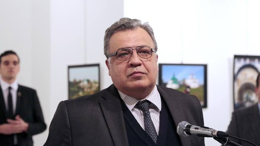 Andrei Karlov, the Russian Ambassador to Turkey, pauses during a speech at a photo exhibition in Ankara on Monday, Dec. 19, 2016, moments before a gunman opened fire on him. Karlov was rushed to a hospital after the attack and later died from his gunshot wounds. (AP Photo/Burhan Ozbilici)