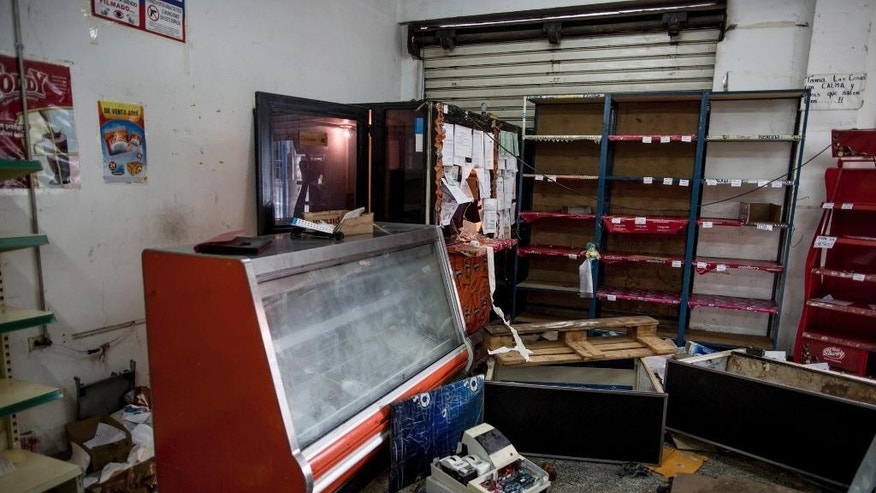 A grocery store is left in disarray after it was looted by demonstrators the night before, in Ciudad Bolivar, Venezuela, Monday, Dec. 19, 2016. Last week, President Nicolas Maduro made an announcement annulling all 100-bolivar notes leading to massive lines at banks, and cash transactions such as buying food or gasoline extremely difficult. Maduro suddenly changed course late Saturday, announcing the 100-bolivar notes could be used until Jan. 2 Before that announcement riots and looting broke out in several cities. (AP Photo/Alejandro Cegarra)