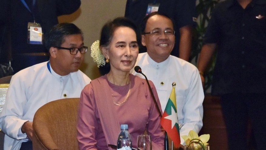 In this photo released by Myanmar State Media, Myanmar Foreign Minister Aung San Suu Kyi, center, attends a meeting with foreign ministers from Association of Southeast Asian Nations (ASEAN) at a hotel in Yangon, Myanmar Monday, Dec.19, 2016. (Myanmar State Media via AP)