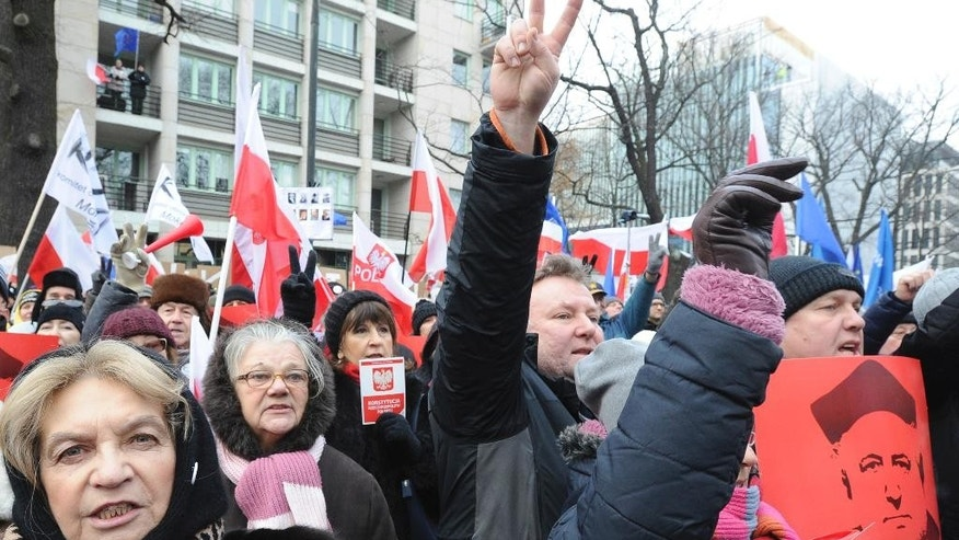 Protesters shout slogans during an anti-government demonstration in front of the Constitutional Court, in Warsaw, Poland, Sunday, Dec. 18, 2016. Opponents of the country's populist government are staging protests in an appeal to protect the young democracy's constitutional order from a series of government steps they deem anti-democratic. (AP Photo/Alik Keplicz)