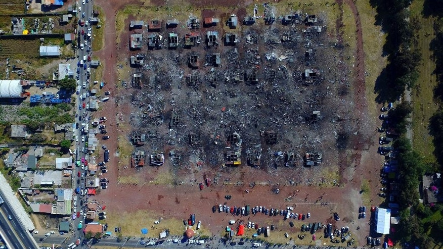 A fireworks market lays in ruins one day after an explosion at the San Pablito Market in Tultepec on the outskirts of Mexico City, Wednesday, Dec. 21, 2016. The market was especially well stocked for the holidays and bustling with hundreds of shoppers when a powerful chain-reaction explosion ripped through its stalls Tuesday, killing and injuring dozens. (AP Photo/Christian Palma)