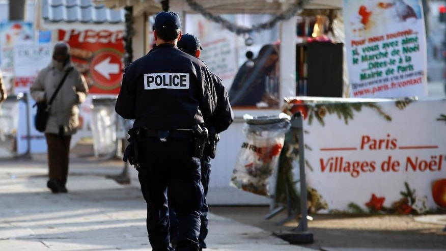 French Police officers patrol in the Champs Elysee Avenue Christmas market in Paris, Tuesday, Dec. 20, 2016 the day after a truck ran into a crowded Christmas market killing a number of people Monday evening in Berlin, Germany. (AP Photo/Francois Mori)