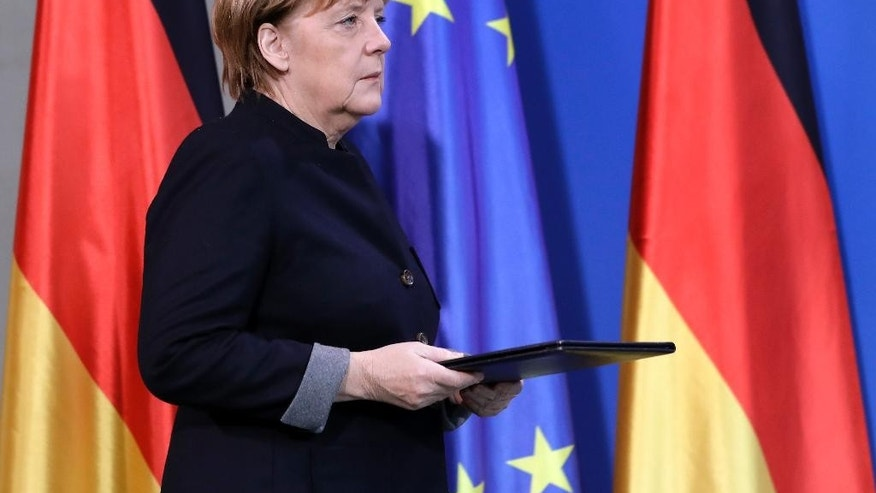 German Chancellor Angela Merkel arrives for a statement at the chancellery in Berlin, Germany, Tuesday, Dec. 20, 2016 the day after a truck ran into a crowded Christmas market and killed several people. (AP Photo/Michael Sohn)