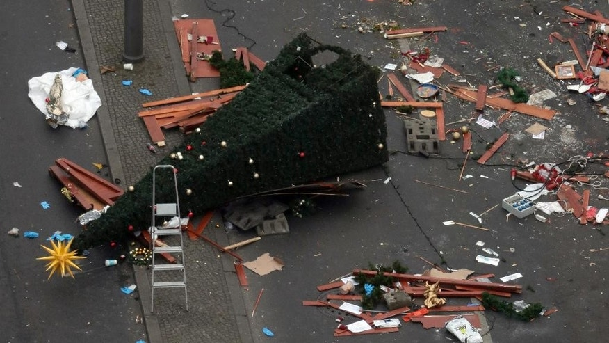A trail of devastation is left behind in Berlin, Germany, Tuesday, Dec. 20, 2016, the day after a truck ran into a crowded Christmas market and killed several people. (AP Photo/Markus Schreiber)