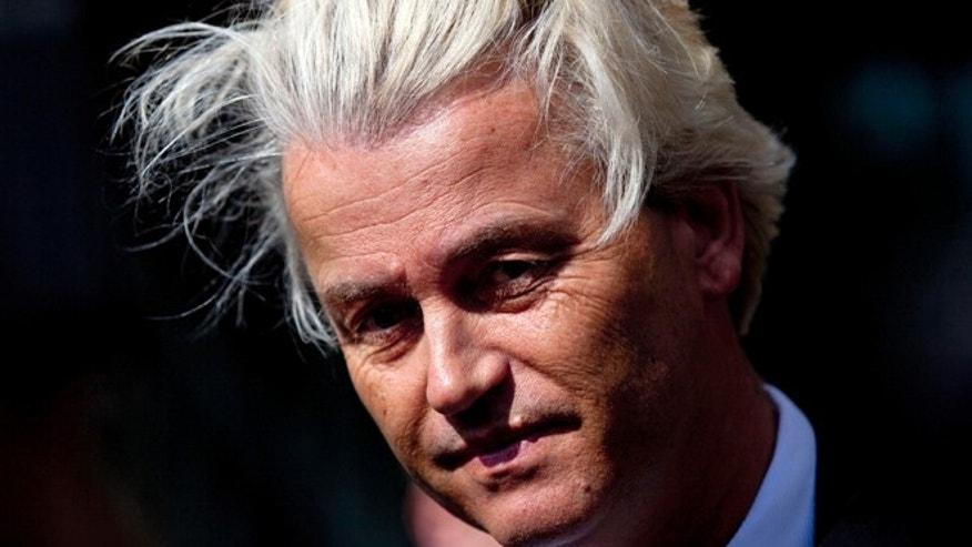 May 12, 2014: Dutch lawmaker Geert Wilders pauses as he speaks to journalists outside the Dutch National Bank in Amsterdam.