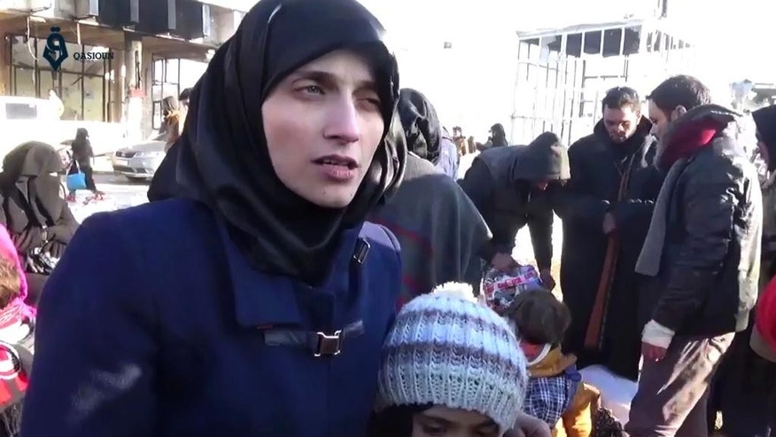 This image made from video released by Qasioun News Agency, a media opposition platform with reporters inside Syria, shows Fatemah Alabed, with her 7-year-old daughter Bana, speaking after they reached the Aleppo countryside following the evacuation of their city, Syria.