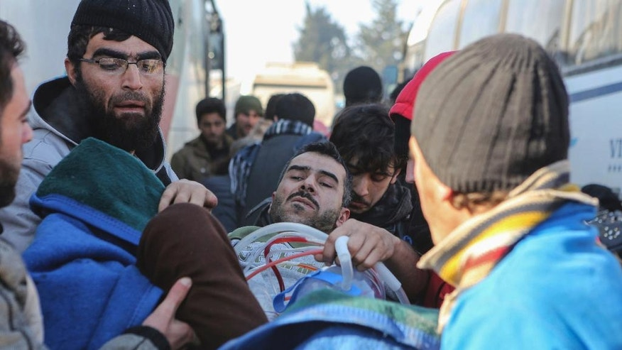 An injured Syrian arrives at a refugee camp in Rashidin, near Idlib, Syria, after was evacuated from the embattled Syrian city of Aleppo during the ceasefire, Tuesday, Dec. 20, 2016. Russian Foreign Minister Sergey Lavrov said on Tuesday that Russia, Iran and Turkey are ready to act as guarantors in a peace deal between the Syrian government and the opposition. He spoke on Tuesday after a meeting of the three countries' foreign ministers in Moscow. (AP Photo)