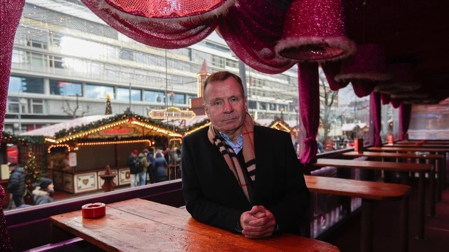 Eye witness Axel Kaiser poses for a photo at his restaurant at the reopened Christmas market, three days after a truck ran into the crowd and killed several people, at the Kaiser Wilhelm Memorial Church in Berlin, Thursday, Dec. 22, 2016. The restaurant's name is 'Christmas Terrace'. (AP Photo/Markus Schreiber)