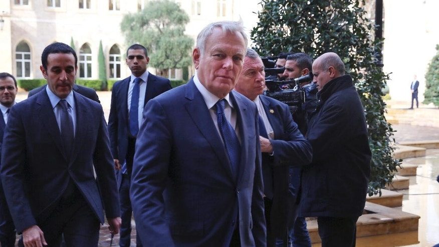 French Foreign Minister Jean-Marc Ayrault, arrives to meets with Lebanese Prime Minister Saad Hariri, at the Government House in downtown Beirut, Lebanon, Thursday, Dec. 22, 2016. Ayrault is in Beirut to meet with Lebanese officials. (AP Photo/Bilal Hussein)