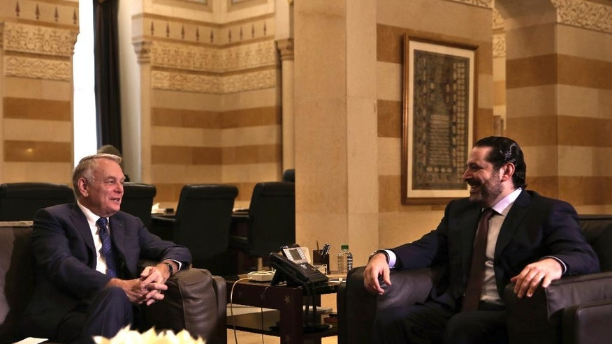 Lebanese Prime Minister Saad Hariri, right, meets with French Foreign Minister Jean-Marc Ayrault at the Government House in downtown Beirut, Lebanon, Thursday, Dec. 22, 2016. Ayrault is in Beirut to meet with Lebanese officials. (AP Photo/Bilal Hussein)