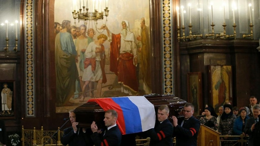 A coffin with a body of killed Russian ambassador to Turkey, Andrei Karlov is carried for a religious service inside the Christ the Saviour Cathedral in Moscow, Russia, Thursday, Dec. 22, 2016. Karlov was fatally shot by a Turkish policeman Monday in a gathering in Ankara, Turkey. (AP Photo/Alexander Zemlianichenko)