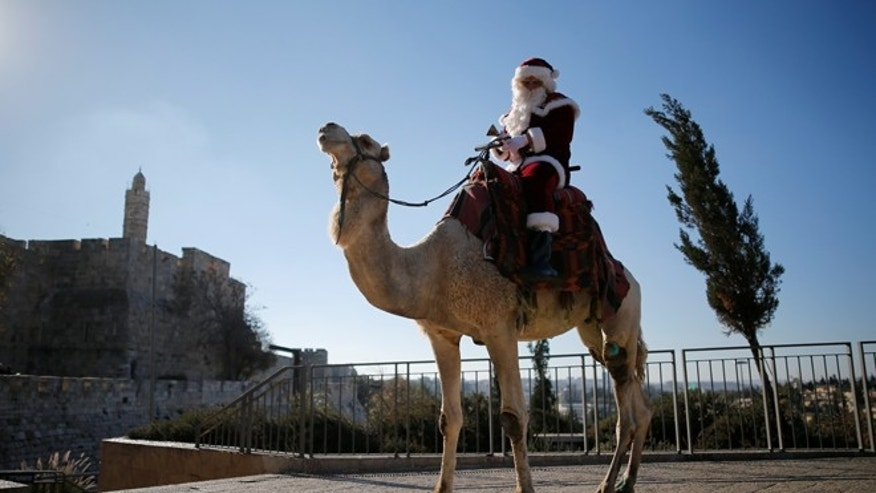 An Israeli Arab wears a Santa Claus costume as he rides a camel in Jerusalem's Old City on Dec. 20, 2016. Such an act would be illegal in Saudi Arabia, where any non-Muslim worship or celebration is puniishable by death, imprisonment or lashes. (Photo: REUTERS/Amir Cohen)