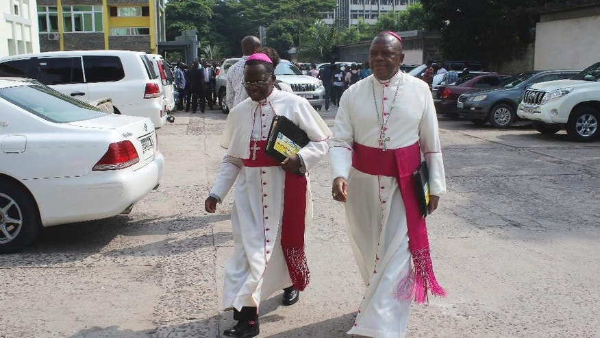 Congo Catholic priests arrive for meeting in Kinshasa, Democratic Republic of Congo, Wednesday, Dec. 21, 2016. Mediators urged Congo's president and opposition parties Wednesday to reach an agreement before Christmas on a peaceful settlement to the country's political crisis, saying dozens already have been killed this week amid protests over the president's stay in power. (AP Photo/John Bompengo)