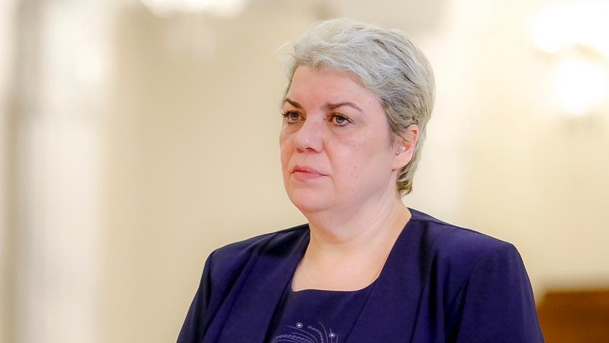 In this photo taken May 20, 2015, Sevil Shhaideh, 52, stands at the Romanian presidency before being sworn in as regional development minister in Bucharest, Romania. Liviu Dragnea, chairman of Romania's Social Democratic party, which won the parliamentary election, proposed Wednesday, Dec. 21, 2016 that Sevil Shhaideh take the post of prime minister.(AP Photo/Octav Ganea)