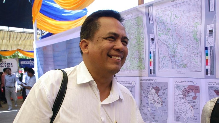 FILE - In this April, 6, 2016, file photo, Cambodian prominent political analyst Kem Ley smiles as he celebrates the 67th anniversary to commemorate the Kampuchea Krom territory's return to Vietnam by the French government at Chroy Changvar in Phnom Penh, Cambodia. Kem Ley, a poor farmer's son turned champion of Cambodia's have-nots, was killed in a still-unresolved case that has both silenced opposition figures and ignited a pro-democracy surge. Many blame the murder on the government of Prime Minister Hun Sen, which over the past year has jailed and intimidated critics in apparent moves to retain power after the 2018 general elections. (AP Photo/Heng Sinith, File)