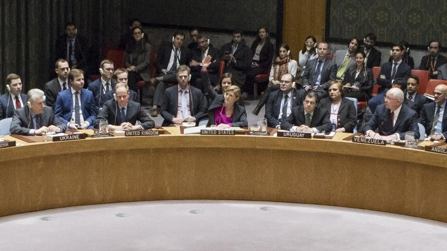 In this photo provided by the United Nations, Samantha Power, center, the United States Ambassador to the United Nations, votes to abstain during a U.N. Security Council vote on condemning Israel's settlements in the West Bank and east Jerusalem, Friday, Dec. 23, 2016 at United Nations Headquarters. (Manuel Elias/The United Nations via AP)