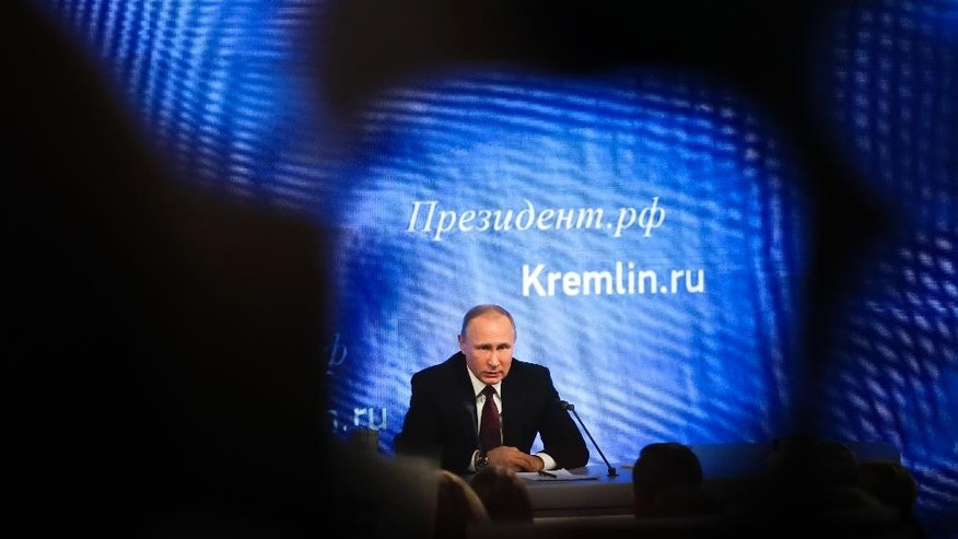 Russian President Vladimir Putin speaks during his annual news conference in Moscow, Russia, Friday, Dec. 23, 2016. Putin says U.S. Democrats should have apologized to American voters over the information revealed by hackers who posted Democratic National Committee e-mails. (AP Photo/Pavel Golovkin)