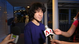FILE - In this Tuesday, May, 12, 2015, file photo, Singapore teen blogger Amos Yee speaks to reporters while leaving the Subordinate Courts after being released on bail in Singapore. Yee whose video posts and blogs mocking his government and its late founder landed him in jail twice has been detained in the U.S. where he is seeking asylum. Human Rights Watch called on the U.S. to recognize Amos Yee's asylum claim, saying he has been consistently harassed in Singapore for publicly expressing his views. (AP Photo/Wong Maye-E, File)