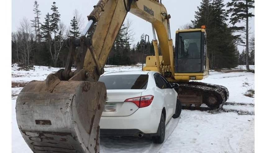 Cops say this excavator helped apprehend a drunk driver Thursday afternoon. (Queens District RCMP)