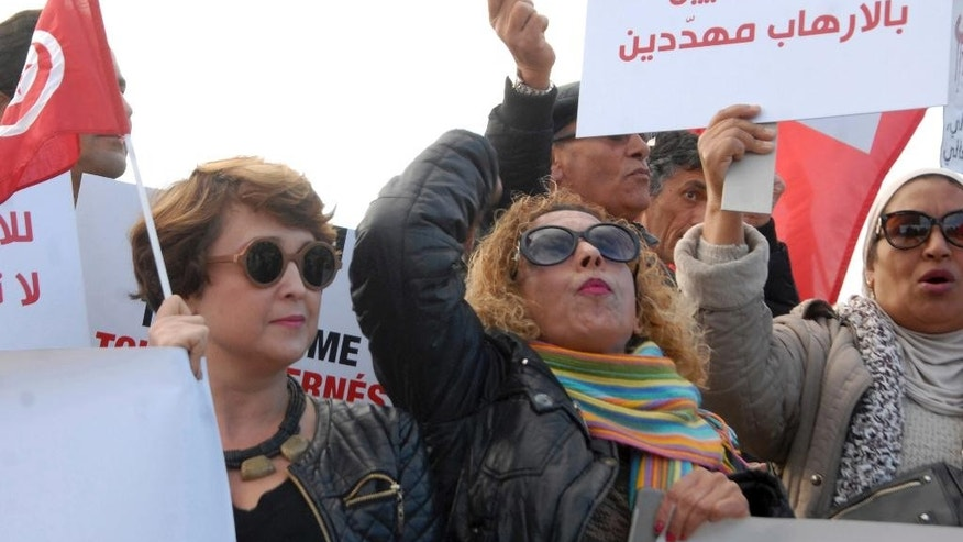 Women demonstrate outside the Tunisian parliament, in Tunis, Saturday, Dec. 24, 2016. About 200 people have protested in the Tunisian capital against the return of Tunisian jihadis who have fought abroad.The gathering was prompted by the deadly truck attack in a Berlin Christmas market by Tunisian Anis Amri, who had pledged allegiance to the Islamic State group and was killed Friday in a police shootout. Amri, 24, was slated to be deported home from Germany. Banner reads 'We are all concerned by terrorism.' (AP Photo)