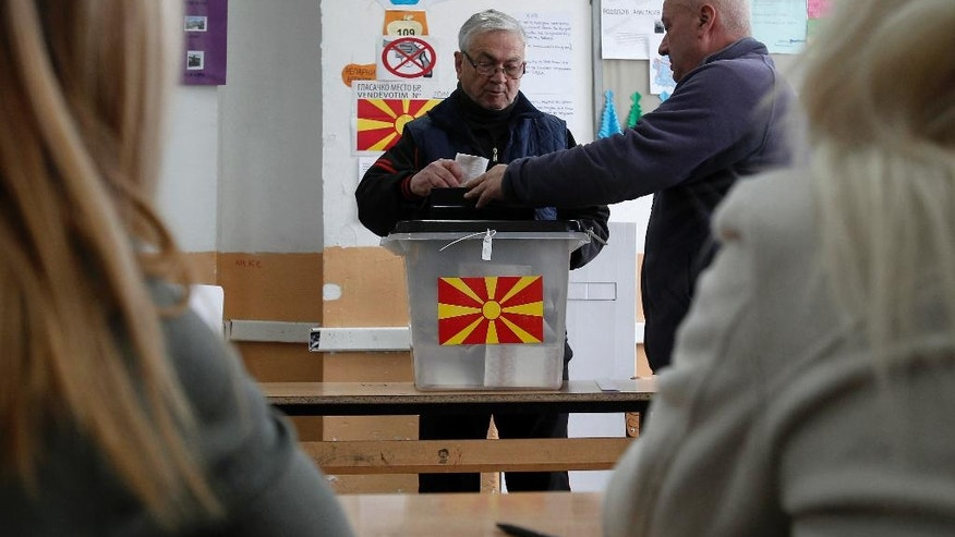 A man casts his ballot at a polling station in village of Tearce, in northwestern Macedonia, on Sunday, Dec. 25, 2016. Authorities in Macedonia have ordered a Christmas Day rerun of a parliamentary election in one voting district - a decision that could threaten the slim majority of the long-governing conservatives. (AP Photo/Boris Grdanoski)