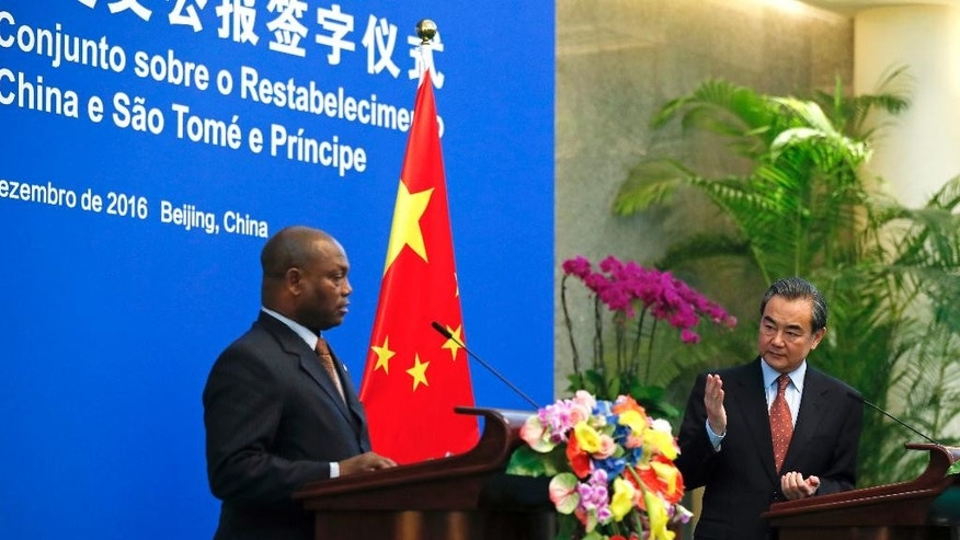Chinese Foreign Minister Wang Yi, right, speaks next to his Sao Tome counterpart Urbino Botelho during a joint press statement at the Diaoyutai State Guesthouse in Beijing, Monday, Dec. 26, 2016. China and Sao Tome and Principe officially resumed diplomatic relations on Monday, in a triumph for Beijing over rival Taiwan after the African island nation abruptly broke away from the self-ruled island last week. (AP Photo/Andy Wong)