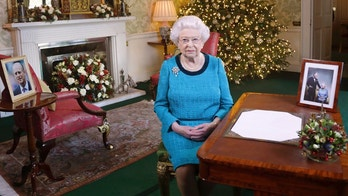 In this photo released early Sunday Dec. 25, 2016, Britain's Queen Elizabeth II poses for a photo, sitting at a desk in the Regency Room of Buckingham Palace in London, after recording her traditional Christmas Day broadcast to the Commonwealth. Queen Elizabeth prerecords her traditional Christmas Day festive speech to be broadcast to the British Commonwealth nations on Christmas Day. (Yui Mok / Pool via AP)