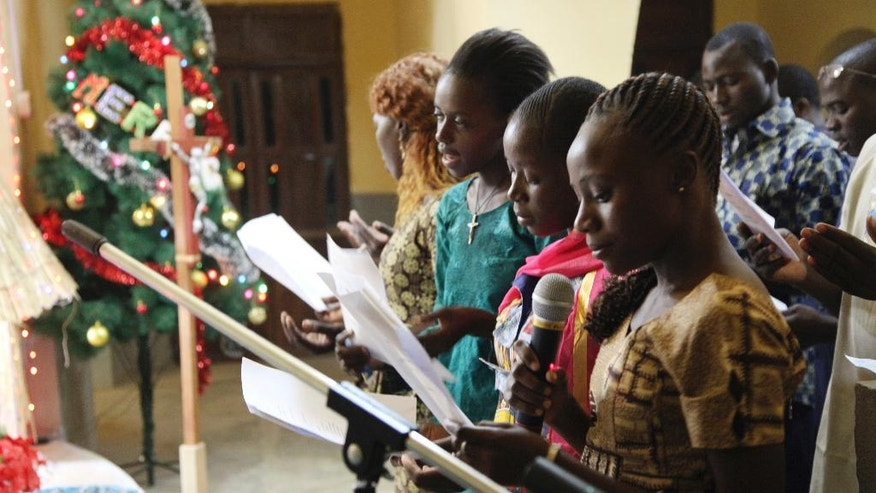 In this photo taken Saturday, Dec. 24, 2016, Catholic faithfuls sing during a mass to celebrate Christmas at Philippe Amore Catholic Church in Goa, Mali. Just four years ago strict Islamic law was in force in this town, but Christians have returned to rebuild their congregation that fled the jihadist occupation. (AP Photo/Baba Ahmed)