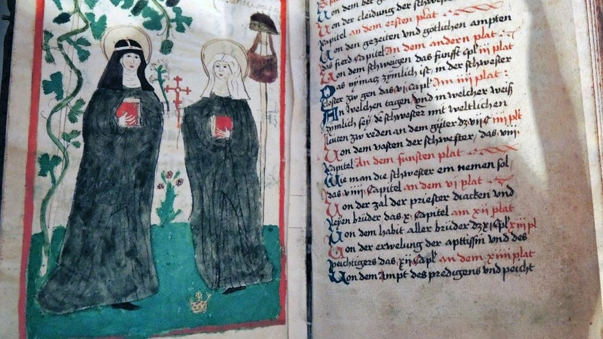 The undated reproduction shows a religious book which was found in library of the abbey in Altomuenster, southern Germany. With the closure of the abbey of the uniquely women-led Bridgettine Order the more than 500 books of the library are stored in other locations. (AP Photo)