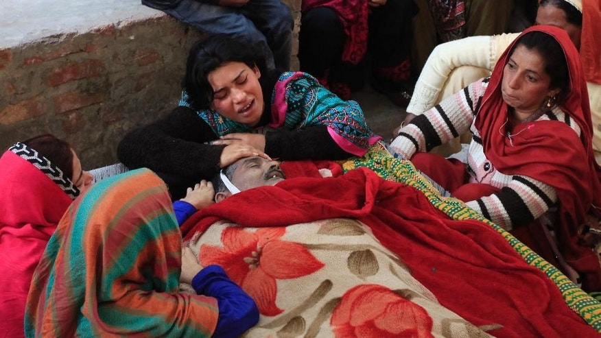 Pakistani women mourn the death of their family member in Toba Tek Singh, Pakistan, Tuesday, Dec. 27, 2016. Local police officer Atif Imran Qureshi said Tuesday that over two dozens people were killed and many transported to hospitals after they consumed contaminated alcohol during the Christmas holiday. (AP Photo/Mian Iftikhar Ahmed)